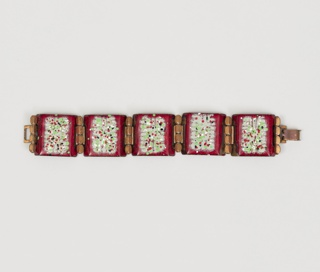 Flexible cuff of  copper links, five with enamel decoration, accented with six leaflike designs between them