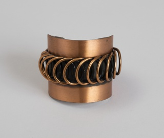 Cuff bracelet of two bands of copper linked with loops of copper wire at center