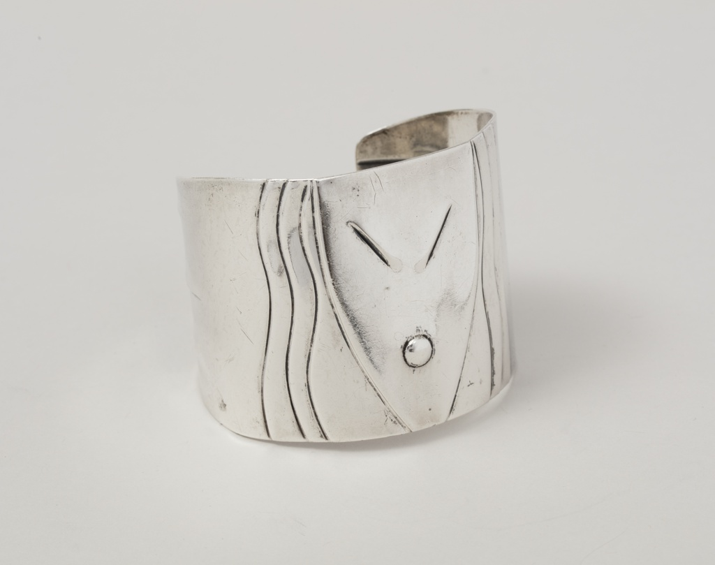 Cuff with abstracted African mask