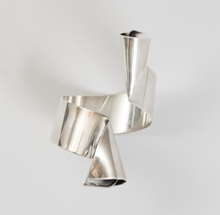 Cuff with molded cone shapes at each end