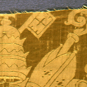 Yellow damassé showing the Pope's crown and crossed keys, Bishops' mitres and staves, and a Cardinal's hat with two tassels enclosed in a cartouche.