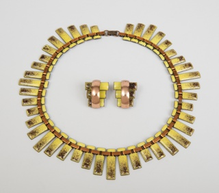 """Copper and enamel necklace in the style of """"Peter Pan"""" with elongated rectangular sections in four alternating widths"""