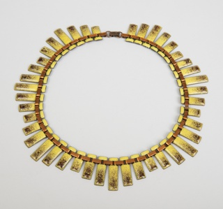 "Copper and enamel necklace in the style of ""Peter Pan"" with elongated rectangular sections in four alternating widths"