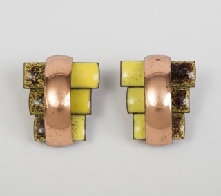"Copper and enamel earrings in the style of ""Peter Pan"" with elongated rectangular sections in three alternating widths"