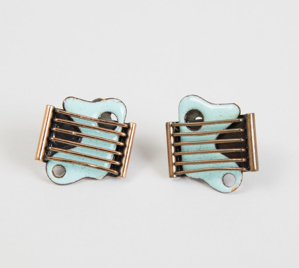 Copper earrings of six cross bars with applied biomorphic placque in blue enamel