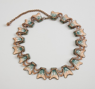 Cooper necklace of biomorphic form with accents of white and blue enamel
