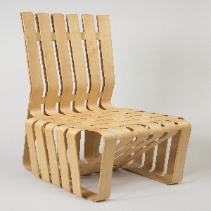 Tall-backed side chair composed of strips of light-colored maple curved and glued to form back, seat and base; strips within rectangular seat interwoven to form flat surface.