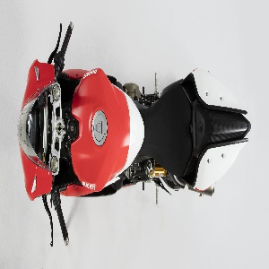 Two-cylinder motorcycle of red and white streamlined carbon fiber and titanium body