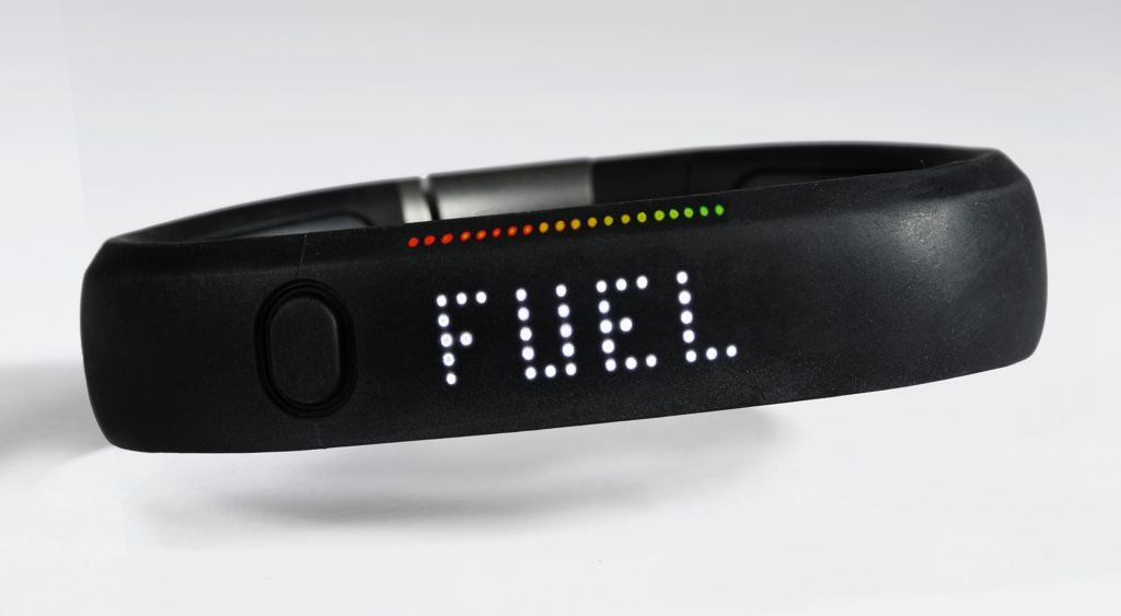A black wrist band with button at front left; rainbow LED matrix lights up with a button press or user motion.