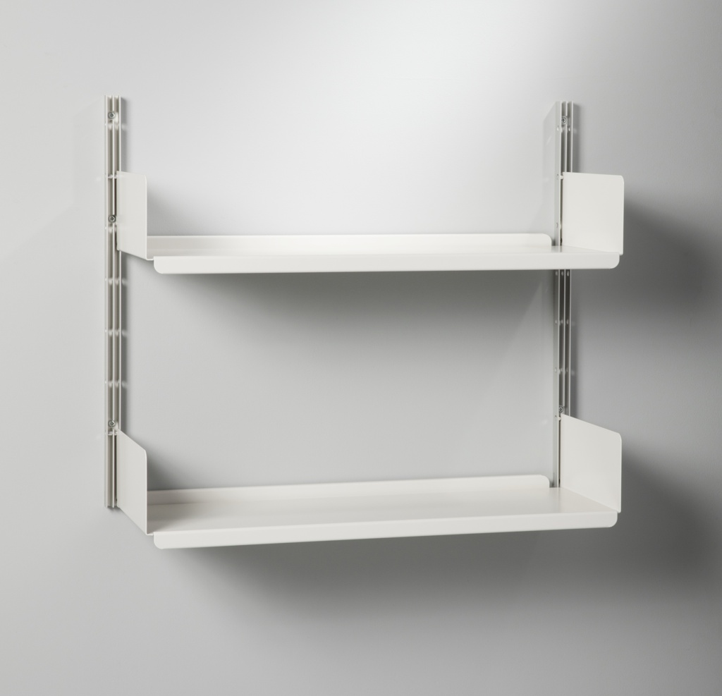 Two wall-mounted off-white shelves on two metal E-tracks