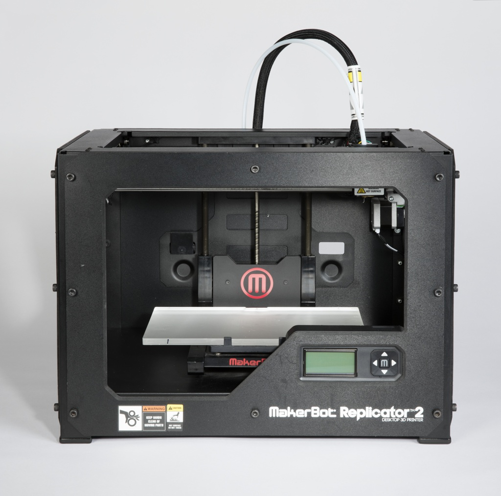 3D printer with rectangular powder-coated steel frame that houses an acrylic build platform, pvc panels, motors, bronze XYZ bearings, and an LCD screen.