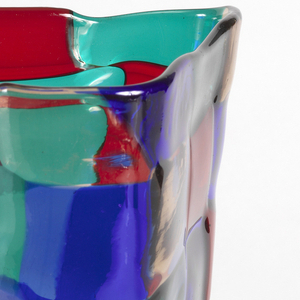 Tall irregular triangular body of fused squares of transparent blue, green, red and clear glass.
