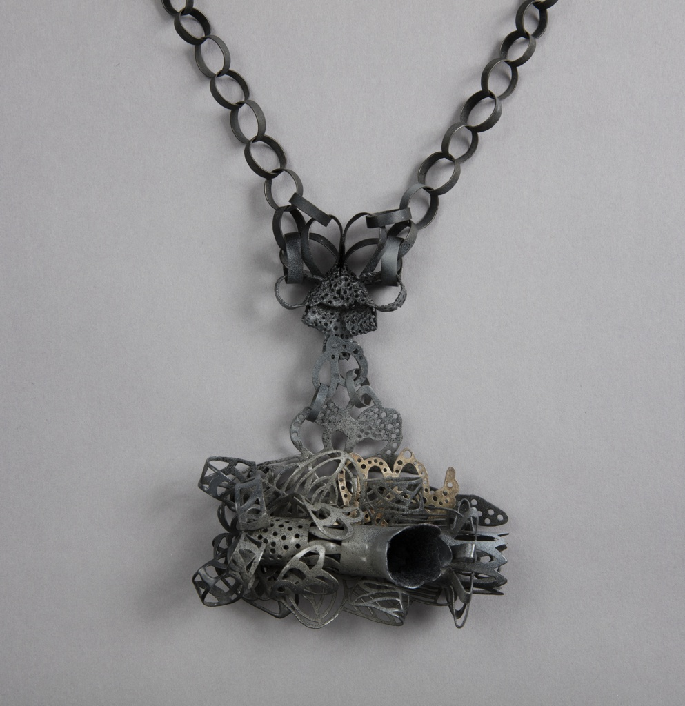 Necklace composed of loops with pendant comprised of interlocking and overlapping loops and shapes.