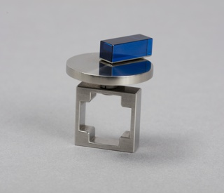 Square ring mounted with horizontal disk with moveable blue acrylic rectangle.