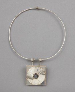 Circular choker style necklace with hand crafted square focal point with a raised circular element containing a grey stone (grey moonstone?)