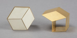 Cube on cube-form gold ring with textured surface.