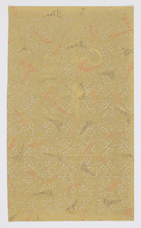 Design resembles a tea chest paper with a filigree or tracery pattern in metallic gold printed over a ground with spots of orange.