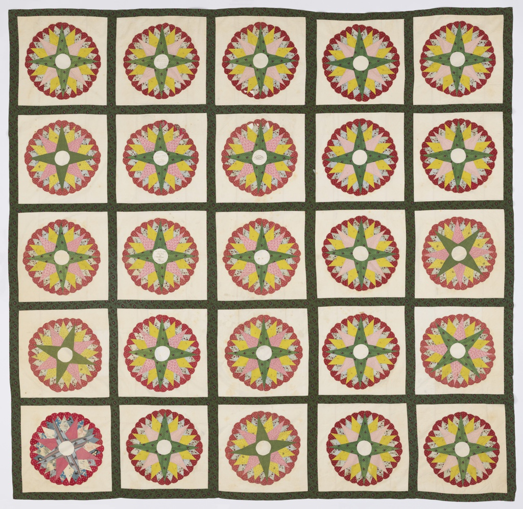 Small pieces of printed cotton in various colors patched to form a star medallion with scalloped outer edge. Each medallion set in white cotton about eighteen inches square. Twenty-five squares, each five by five inches, joined in a grid of strips of printed cotton, predominantly green. The center of each medallion plain white and several have handwritten inscriptions: