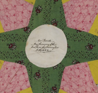 """Small pieces of printed cotton in various colors patched to form a star medallion with scalloped outer edge. Each medallion set in white cotton about eighteen inches square. Twenty-five squares, each five by five inches, joined in a grid of strips of printed cotton, predominantly green. The center of each medallion plain white and several have handwritten inscriptions:  """"Our mother / The First to Cherish / The last to desert us. / Wm D. Jones / Frances L. Jones / May 11, 1845.""""  """"Made by Our Mother / Lacy Jones/ for / I.S. and M.P. Jones / 1845 / in her 64th year.""""  """"Our Parents / May the Evening of their / lives be as the morning sun / I.P. and M.E. Jones."""""""