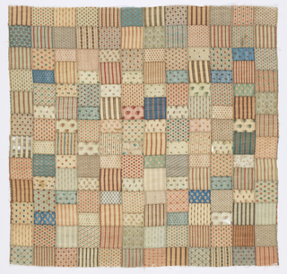 Fragment of a quilt top of approximately 144 squares of challis wool (5 x 5 in.) stitched together to form a large square. In pastel and faded colors, either small allover geometric, floral patterns or a variety of stripes. There are a few duplicates.