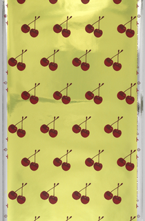 Repeating design of a pair of red cherries, connected by a stem. Printed in shades of red on a green Mylar-foil ground. The red pigments contain microencapsulated oils scented with a cherry fragrance. This is the scratch and sniff version, can also be purchased without the scent.