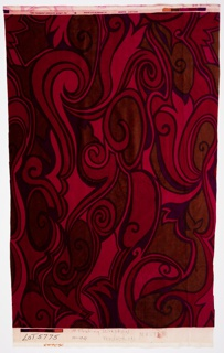 Swirling design in dark red, magenta, blue and purple.