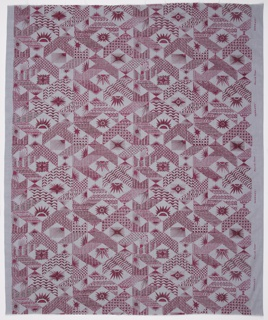 Length of printed textile with design of pink and brown suns surrounded by geometric pattern, on a gray ground.
