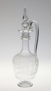 """Mouth-blown crystal pitcher with stopper, cut and polished ornamental engraving in the """"Greek"""" style."""