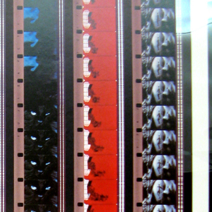 Image of multiple film strips line up next to one another with the same repeating image.