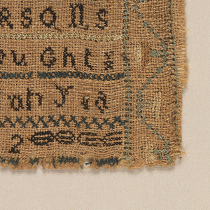 Two fragments of a long sampler stitched together, embroidered in black, green and yellow on a darkened linen ground.  The top half has alphabets and the inscription with a floral vine border; the lower half has many horizontal bands of simple stitches and patterns, and an alphabet.