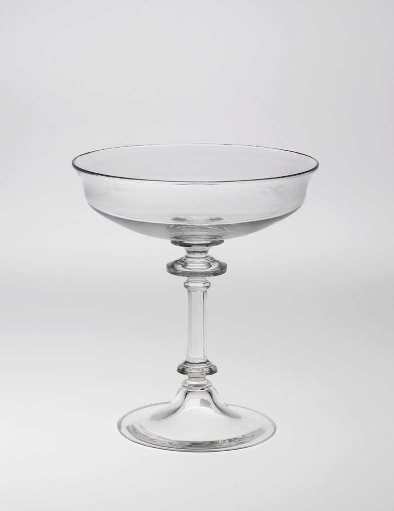 "Mouth-blown crystal champagne glass, cut and polished in the ""Greek"" style."