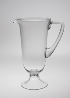 Thin, mouth-blown thin crystal water pitcher, facet-cut and polished base.