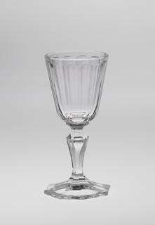 Mouth-blown crystal wine glass, elaborately facet-cut and polished, with precisely planned bubble in the stem.
