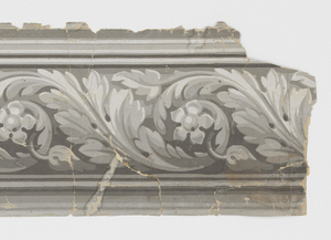 Acanthus rinceau containing floral motif in center. This wider band runs between two narrower bands of architectural molding. Printed in grisaille on gray ground.