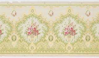 Large scrolling medallions, each containing a basket with floral bouquet. A suspended floral wreath hangs between each medallion. Printed in red, green and metallic gold on light green ground.