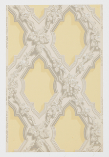 """Representing ornamental plaster form of decoration in English Gothic used in the first half of the 19th century. Composed of criss-crossing wide bands ornamented with leaves, flowers, nuts and fruits. Bands are edged with simulated moldings. A reproduction of an old wallpaper from the walls of the front entry of John Sible's house, Hancock Street, Salem, Massachusetts. It was put on walls in 1858. Printed on reverse side: """"No. 295 CB"""". Printed in grisaille on pale gold field. Not original colors."""