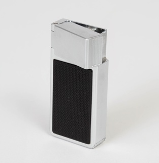Rectangular ligher with plated metal body and black-colored gridded grips at front and back; ignition rotates out of the contour of the lighter casing horizontally.