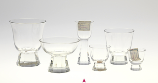 Mouth-blown crystal, bell-shaped cordial glass, facet-cut and polished tall base.