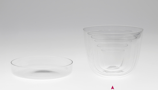 Thin mouth-blown crystal flower bowl with lid.