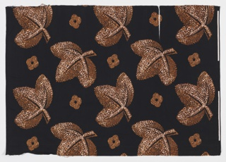 Yard goods; large brown leaves on a black ground, a Soap 'n' Water design created by Associated American Artists, 1957.