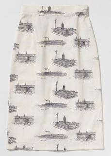 White cotton skirt printed in black with images of the New Ayer Mill, Pacific Mills and Printworks, and Upper Pacific Mill in a repeating pattern. Back zipper closing, button waistband, kickpleat.