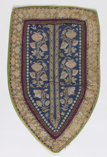 Shaped piece made up of different fabrics. Principal piece was probably originally intended as neck opening for a robe.