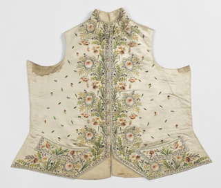 Gentleman's waistcoat with a dense border design at bottom and front of large fantastical flowers. Body has a detached arrangement of small leaves and floral sprigs.