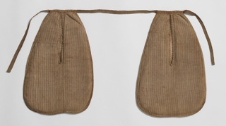 Pair of pockets in brown striped linen on a linen base, held together with woven tape.