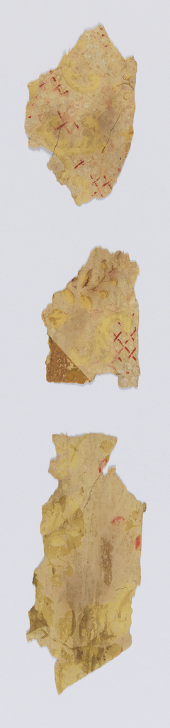Three small fragments of a floral trellis design. Most of the design and pigment has been worn off the surface. Mica polka dots in and around trellis.