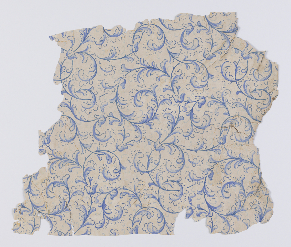 All-over pattern of blue scrolling leaves. Printed in three shades of blue and mica on a white ground.