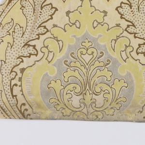 """a) On off-white patterned ground, alternating fleur-de-lis-like motif highlighted and shadowed to appear embossed; b,c) both contain the same design. Diaper pattern with acanthus medallions containing foliate motif. Printed in yellow-green and metallic silver on off-white moire background. b. On gold metallic ground, alternating medallions of metallic silver and gold framed by plumes of gold with grey-blue dots. c. same as """"b"""" above"""