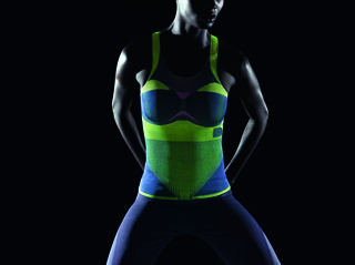 Sport top knitted in black and neon green, with knitted mesh areas for breathability, shaped goring, and knitted-on pocket for removable NFC chip or other electronic devices.