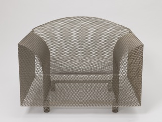 Cubic-form armchair with curved arms and back, composed of welded sheets of steel mesh on four small cylindrical steel mesh feet.