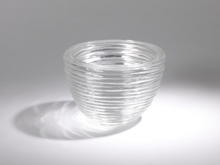 Hemispherical bowl form with open base, and coiled ridges of glass.